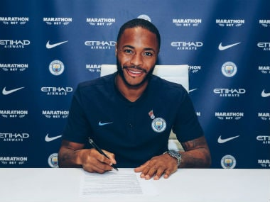 Raheem Sterling poses after signing contract extension. AFP