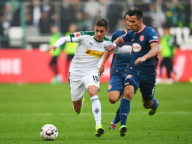 Fortuna Duesseldorf's German-US midfielder Alfredo Morales and Moenchengladbach's Belgian forward Thorgan Hazard vie for the ball during the German first division Bundesliga football match Borussia Moenchengladbach v Fortuna Dusseldorf in Moenchengladbach, western Germany on November 04, 2018. (Photo by Patrik STOLLARZ / AFP) / RESTRICTIONS: DFL REGULATIONS PROHIBIT ANY USE OF PHOTOGRAPHS AS IMAGE SEQUENCES AND/OR QUASI-VIDEO