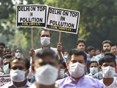Residents protest against increasing levels of pollution in New Delhi. PTI