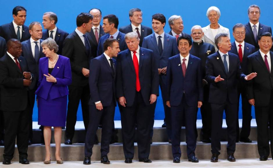 US president Donald Trump chatted with the leaders of Canada, Japan and France as the leaders assembled for a group photo session at the Group of 20 summit in Argentina. AP