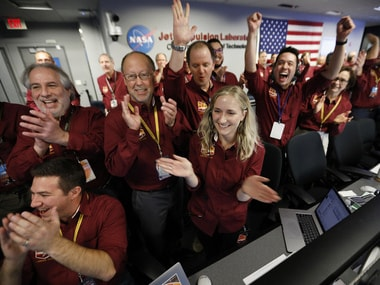 Cheers erupt at NASA California as InSight lands on Mars. AP