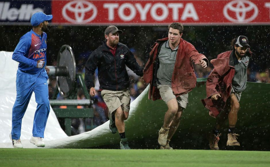 Rain halted play in Brisbane during Australia's innings, the time lost let toreducing the 20-over contest to a 17-over affair with the result determined by the DLS method. AP
