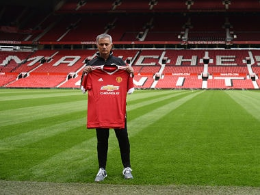 File image of Jose Mourinho posing with club's shirt. AFP
