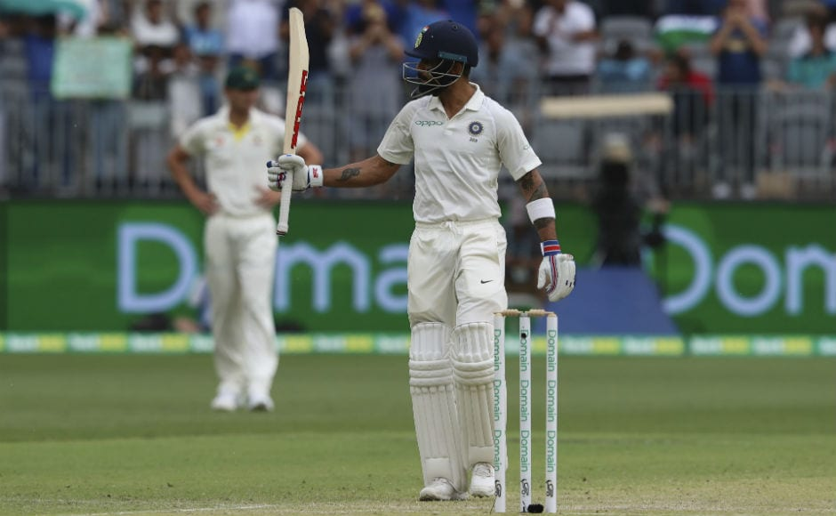 Virat Kohli raises his bat after bringing up his 20th Test half-century. AP