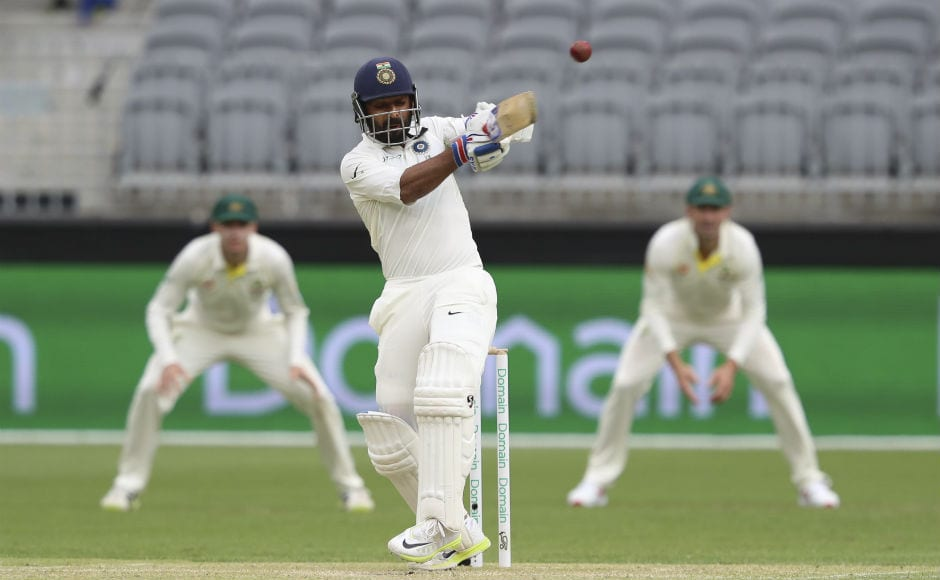Ajinkya Rahane brought up his 17th Test half-century and was unbeaten on 51 at stumps. AP