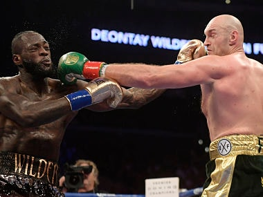 Deontay Wilder (left) and Tyson Fury trade punches during their WBC heavyweight championship boxing match. AP Photo