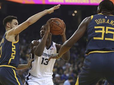 Memphis Grizzlies' Jaren Jackson Jr looks to shoot against Golden State Warriors. AP
