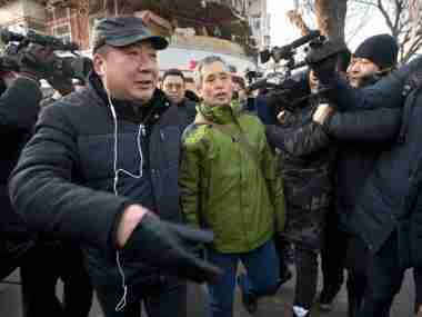 Supporters of Chinese human rights lawyer Wang Quanzhang were taken away by authorities. AP