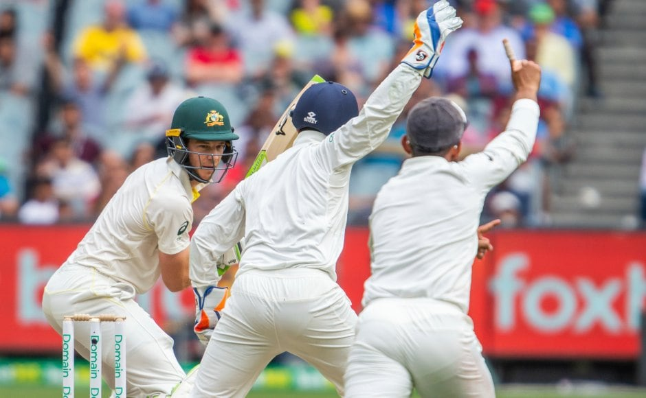 Tim Painewasout caught behind off Ravindra Jadeja's bowling. Australian captain played out 66 deliveries for his 26 before being dismissed. AP