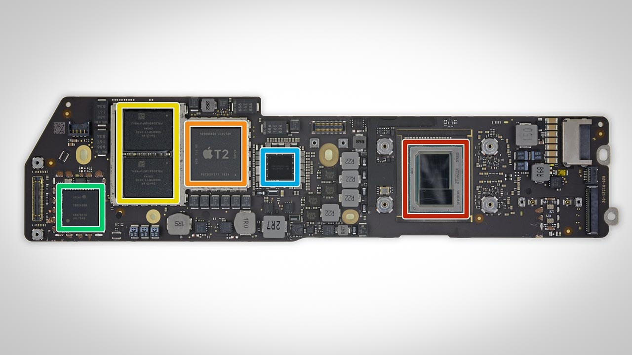 The Air's CPU (red) is so small that it's dwarfed by Apple's T2 security chip (orange).
