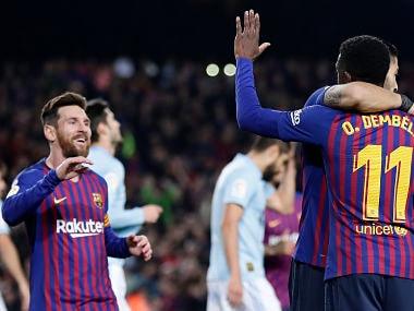 FC Barcelona's Dembele celebrates after scoring during the Spanish La Liga soccer match between FC Barcelona and Celta Vigo at the Camp Nou stadium in Barcelona, Spain, Saturday, Dec. 22, 2018. (AP Photo/Manu Fernandez)