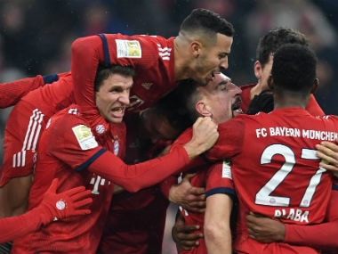 Bayern Munich's Franck Ribery celebrates scoring their first goal with team mates. Reuters