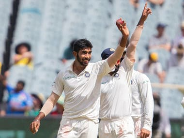 Jasprit Bumrah (L) celebrates after scalping 5th Australian wicket on day 3 of the 3rd Test between India and Australia at the MCG. AP