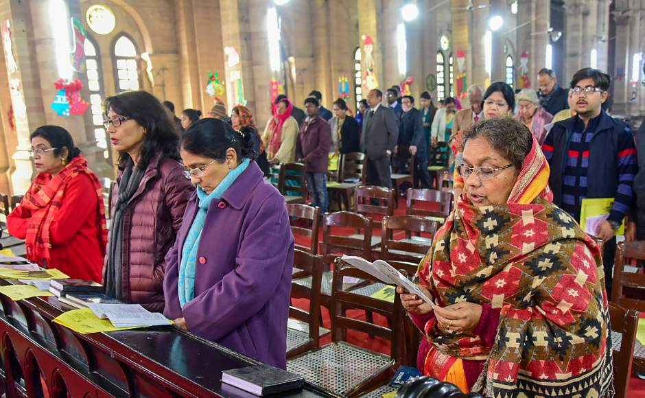 As the clock struck 12 at night, priests came in a procession to announce the birth of Jesus. Children carried candles and the Holy Bible in the procession. PTI