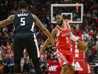 Dec 19, 2018; Houston, TX, USA; Houston Rockets guard Chris Paul (3) dribbles the ball as Washington Wizards forward Markieff Morris (5) defends during the first half at Toyota Center. Mandatory Credit: Troy Taormina-USA TODAY Sports - 11876864