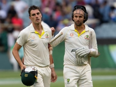 Australia's Pat Cummins (left) and Nathan Lyon (right) walk off the field at the end of play during play on day four of the third cricket test between India and Australia in Melbourne, Australia, Saturday, Dec. 29, 2018. (AP Photo/Asanka Brendon Ratnayake)