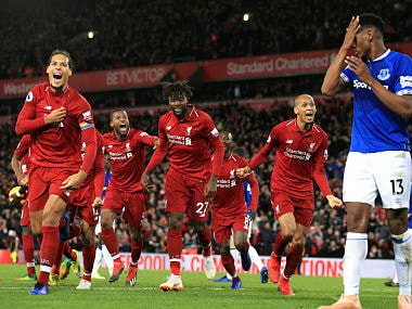 Liverpool forward Divock Origi, center, celebrates after scoring his side's first goal during the English Premier League soccer match between Liverpool and Everton at Anfield Stadium in Liverpool, England, Sunday, Dec. 2, 2018. (AP Photo/Jon Super)