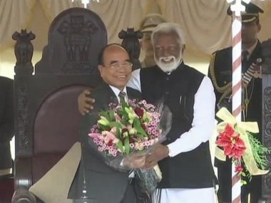MNF chief Zoramthanga greeted by Governor Kummanam Rajasekharan after the oath-taking ceremony. ANI