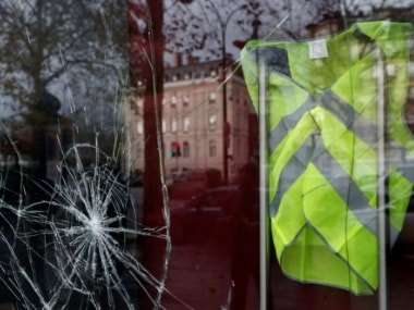 A yellow vest hanged inside a vandalized store on Sunday morning after clashes with protesters wearing yellow vests, a symbol of a French drivers' protest against higher diesel fuel taxes, in Paris, France. Reuters