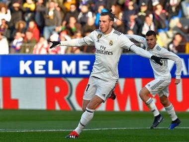 Real Madrid's Gareth Bale (centre) celebrates after scoring against SD Huesca. AFP