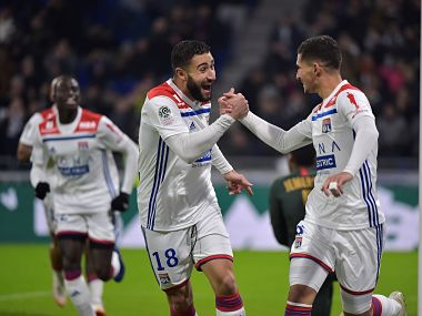 Lyon's French midfielder Houssem Aouar celebrates after scoring a goal with Lyon's French forward Nabil Fekir (L) during the French L1 football match between Lyon (OL) and Monaco (ASM) on December 16, 2018, at the Groupama Stadium in Decines-Charpieu near Lyon, central-eastern France. (Photo by ROMAIN LAFABREGUE / AFP)
