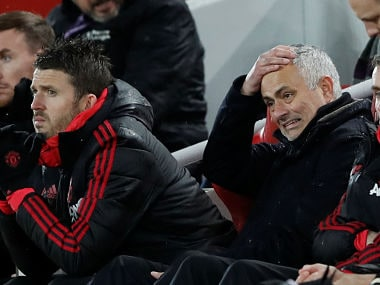 """Soccer Football - Premier League - Liverpool v Manchester United - Anfield, Liverpool, Britain - December 16, 2018 Manchester United manager Jose Mourinho reacts as assistant coach Michael Carrick looks on Action Images via Reuters/Carl Recine EDITORIAL USE ONLY. No use with unauthorized audio, video, data, fixture lists, club/league logos or """"live"""" services. Online in-match use limited to 75 images, no video emulation. No use in betting, games or single club/league/player publications. Please contact your account representative for further details. - RC1DE100C650"""