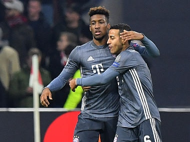 Bayern Munich's French forward Kingsley Coman (L) is congratulated by Bayern Munich's Spanish midfielder Thiago Alcantara after scoring their third goal during the UEFA Champions League Group E football match between AFC Ajax and FC Bayern Munchen at the Johan Cruyff Arena in Amsterdam on December 12, 2018. (Photo by EMMANUEL DUNAND / AFP)