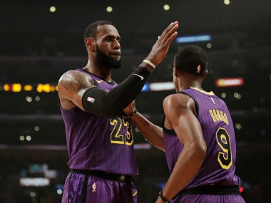 Los Angeles Lakers' LeBron James, left, and Rajon Rondo celebrate a basket by Rondo during the first half of an NBA basketball game against the New Orleans Pelicans, Friday, Dec. 21, 2018, in Los Angeles. (AP Photo/Jae C. Hong)