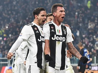 Juventus' Mario Mandzukic, right, celebrates with teammate Mattia De Sciglio, left, and Paulo Dybala after scoring his side's opening goal during the Serie A soccer match between Juventus and Inter Milan at the Turin Allianz stadium, Italy, Friday, Dec. 7, 2018. (Andrea Di Marco/ANSA via AP)