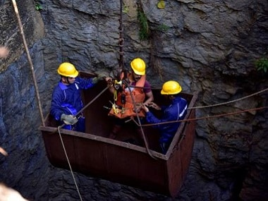 Divers use a pulley to enter the coal mine in Meghaya. Reuters