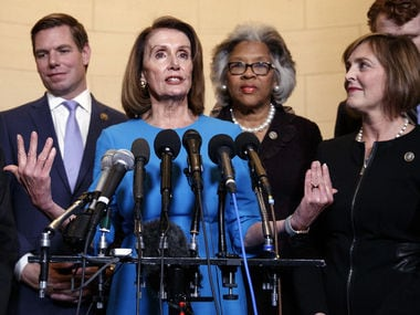 Nancy Pelosi (center) takes over as House speaker 3 January. AP