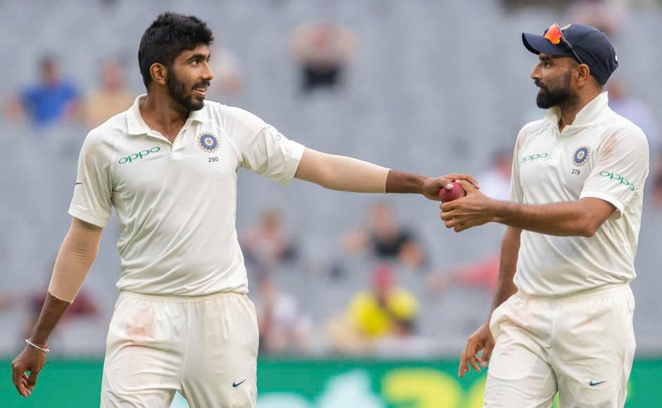 Jasprit Bumrah (left) was adjudged the player of the match for his 9-wicket haul in the match. He picked a six-for in the first innings and scalped three more in the second. AP