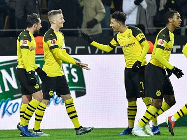 Dortmund's Marco Reus, 2nd for left, is celebrated by Dortmund's Jadon Sancho, right, and Dortmund's Paco Alcacer, left, after he scored his side's second goal during the German Bundesliga soccer match between Borussia Dortmund and Werder Bremen in Dortmund, Germany, Saturday, Dec. 15, 2018. (AP Photo/Martin Meissner)