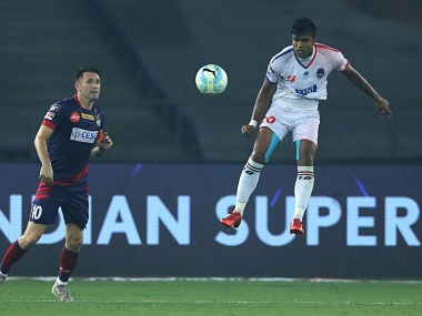 Pritam Kotal of Delhi Dynamos FC and Robert Keane of ATK during match 81 of the Hero Indian Super League between Delhi Dynamos FC and ATK held at the Jawaharlal Nehru Stadium, Delhi, India on the 24th February 2018 Photo by: Arjun Singh / ISL / SPORTZPICS