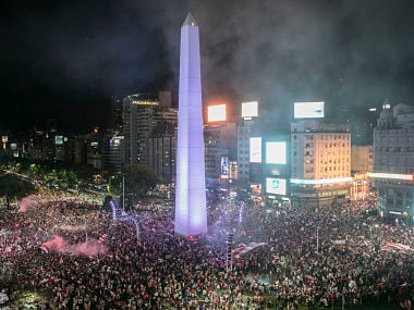 Fans of River Plate celebrate their team's Copa Libertadores win at the Plaza de la Republica, Buenos Aires. AFP