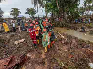Rescue workers carry a body bag containing the remains of a victim of a tsunami at Sumur district in Pandeglang, Banten province, Indonesia. Reuters