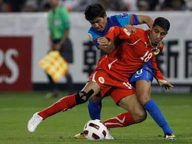 Bahrain's Abdulwahab Ali (18) and India's Renedy Singh fight for the ball during their 2011 Asian Cup Group C soccer match at Al Sadd stadium in Doha. Reuters