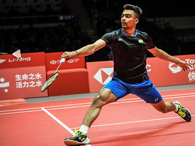 Sameer Verma of India hits a return against Kento Momota of Japan during their men's singles first round match at the 2018 BWF World Tour Finals of badminton in Guangzhou, south China's Guangdong province on December 12, 2018. (Photo by STR / AFP) / China OUT