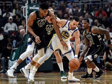 Dec 7, 2018; Milwaukee, WI, USA; Milwaukee Bucks forward Giannis Antetokounmpo (34) puts pressure on Golden State Warriors guard Stephen Curry (30) in the first quarter at the Fiserv Forum. Mandatory Credit: Benny Sieu-USA TODAY Sports - 11806633