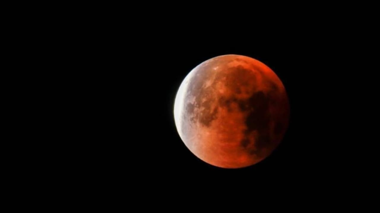 What a super wolf blood moon looks like in progress.