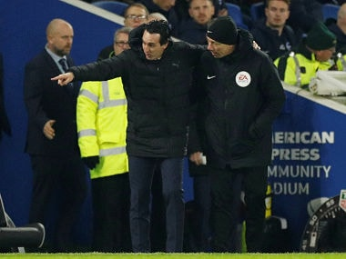 """Soccer Football - Premier League - Brighton & Hove Albion v Arsenal - The American Express Community Stadium, Brighton, Britain - December 26, 2018 Arsenal manager Unai Emery gestures with the fourth official after he kicked a bottle into the crowd Action Images via Reuters/John Sibley EDITORIAL USE ONLY. No use with unauthorized audio, video, data, fixture lists, club/league logos or """"live"""" services. Online in-match use limited to 75 images, no video emulation. No use in betting, games or single club/league/player publications. Please contact your account representative for further details. - RC14CF525890"""
