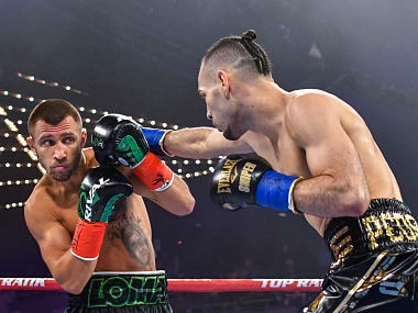 Vasiliy Lomachenko evades a punch from Jose Pedraza in the WBO lightweight title boxing match. AP Photo