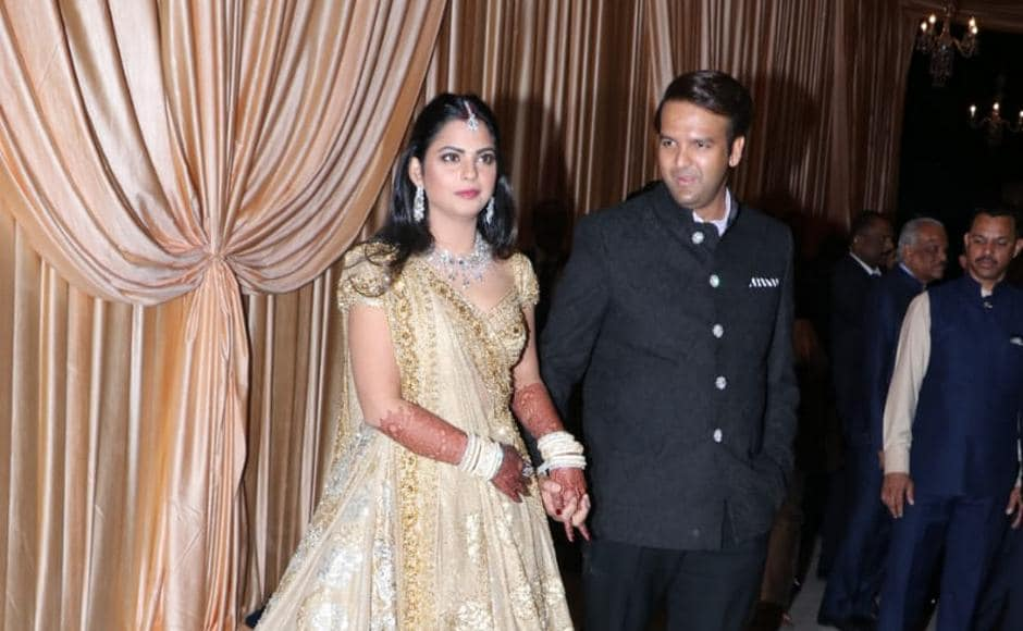 Isha Ambani and Anand Piramal at their wedding reception in Mumbai on Friday. Sachin Gokhale/Firstpost