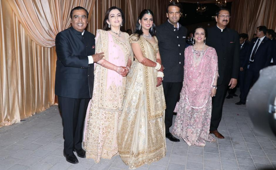 Mukesh Ambani, Nita Ambani and Isha Ambani with Anand Piramal, Swati Piramal and Ajay Piramal. Sachin Gokhale/Firstpost