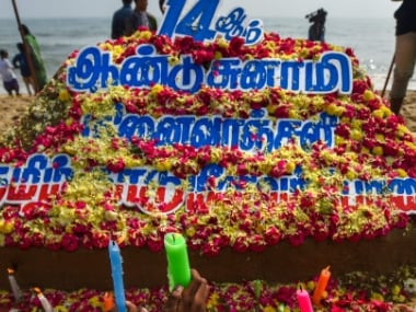People pay tributes to the victims of tsunami 2004 on the 14th anniversary of the calamity, at Foreshore Estate beach in Chennai on Wednesday.