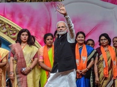 Prime Minister Narendra Modi waves at his supporters as he attends the BJP women's wing National Convention, in Ahmedabad on Saturday. PTI