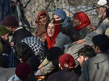 Villagers wail while attending the funeral of civilians and militants in Pulwama. PTI