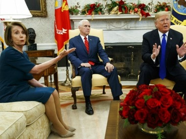 Vice President Mike Pence, looks on as House Minority Leader Rep. Nancy Pelosi argues with President Donald Trump. AP