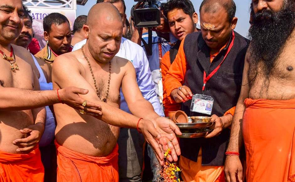 Adityanath offered prayers as he took a dip in River Ganga at Sangam during the Kumbh Mela. The area around Sangam was cleaned and decorated on Monday for the holy dip. PTI