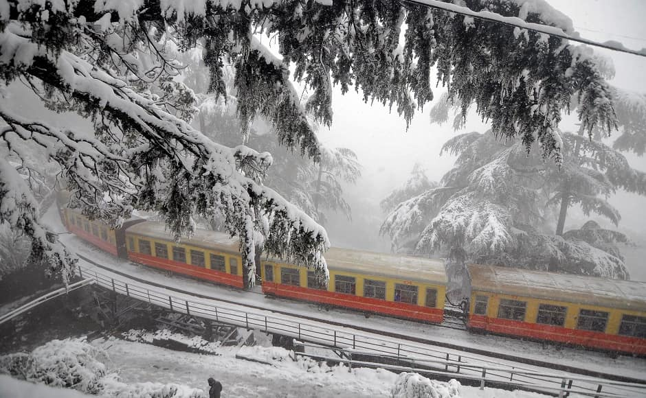 While there were some reports of buses getting stuck in heavy snowfall between Kufri and Chharabra, seen here is a train in Shimla. PTI